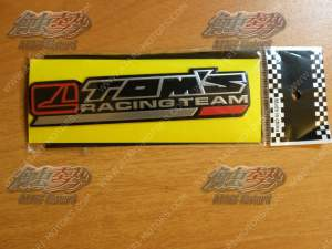 TOM'S aluminium emblem 142x33 mm